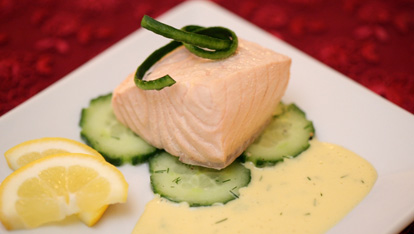 Poached Salmon with Mousseline Sauce garnished with Cucumber and Fresh Dill