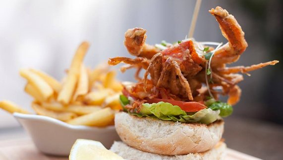 Tuck into a lobster burger and truffle oil chips at Bite