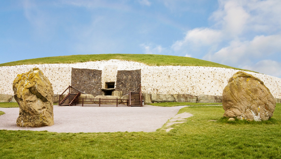 "The facade of the passage tomb at Newgrange provided by <a href=""http://www.shutterstock.com/gallery-280771p1.html"" >UnaPhoto</a>"