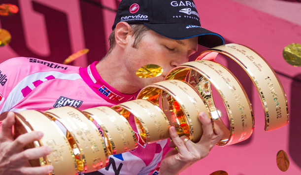 "Ryder Hesjedal wearing the winner's pink jersey as he picks up the title in 2012 provided by <a href=""http://www.shutterstock.com/gallery-308011p1.html"" >William Perugini/Shutterstock</a>"