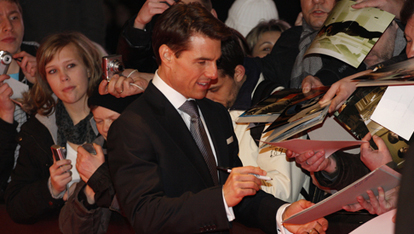 Tom Signing Autographs for all his fans
