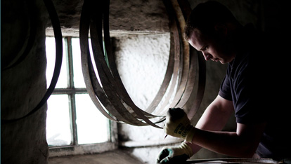 "Cooper Martin working on a cask provided by <a href=""http://www.kilbegganwhiskey.com/"" >Kilbeggan Distillery</a>"
