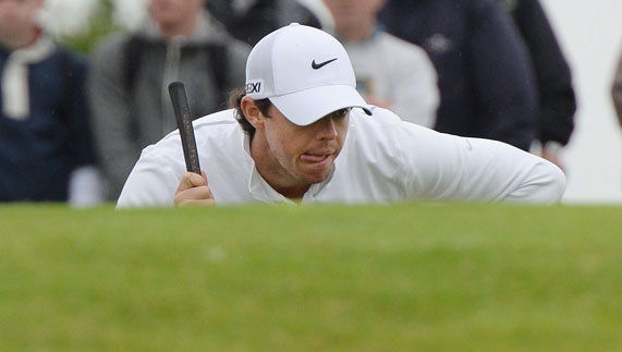 Rory McIlroy analysing a shot