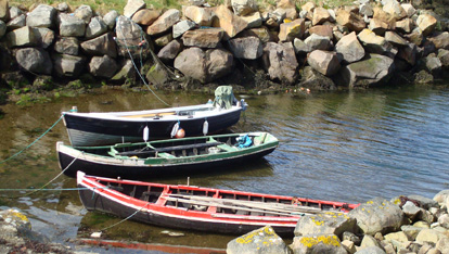 "Curraghs (Currachs in Irish) are a traditional boat  provided by <a href=""http://www.thecreativewritersworkshop.com/"" >Irene Graham</a>"