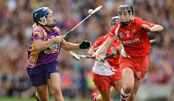 A camogie player in full flight